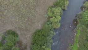 Curve of the river with canyon at the sunset seen from above with the drone stock video