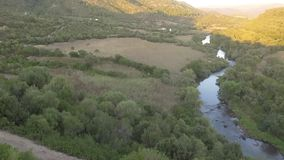 Curve of the river with canyon at the sunset seen from above with the drone stock footage