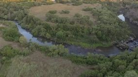 Curve of the river with canyon at the sunset seen from above with the drone stock video footage