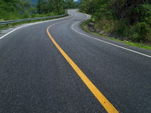 Curve Road. The road curves up the mountain. Line yellow and white road Stock Photos