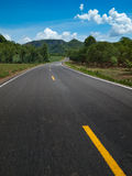 Curve Road. The road curves up the mountain Stock Photo