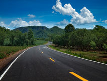 Curve Road. Go to the mountain and sky Royalty Free Stock Photos