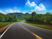 Curve Road. Go to the mountain and sky motion Royalty Free Stock Photography