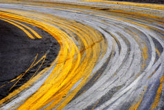 Curve in Road. Road with painted yellow lines and big curve or turn Royalty Free Stock Photos