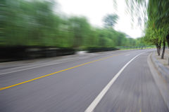Curve road. Background, motion blur Stock Images