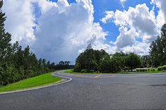 Curve in Road. Big curve in road with dramatic sky overhead Stock Images