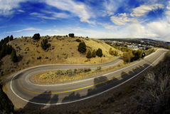 Curve in Road. Country road with painted double yellow lines and big curve or turn Stock Photos