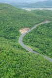 Curve road from above, road with cars through green forest and m royalty free stock image