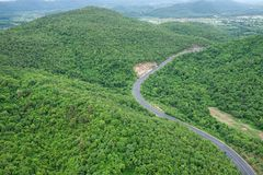 Curve road from above, road with cars through green forest and m stock images