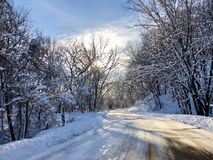 Snowy Valley Curve. A curve in the road along the snowy valley royalty free stock photography