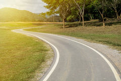 Curve road and bicycle lane Royalty Free Stock Photography