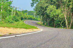 Curve road in forest. Curve road in the forest, country road of Thailand Royalty Free Stock Photo