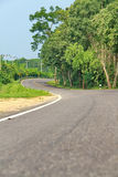 Curve road in forest. Curve road in the forest, country road of Thailand Royalty Free Stock Images