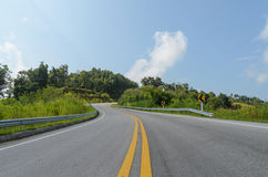 Curve of road and green field in country at nan thailand Royalty Free Stock Photos