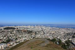 Curve road and landscape view of downtown from Twin Peaks, in Sa royalty free stock image