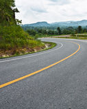 Curve road on mountain. Down hill curve road in thailand Royalty Free Stock Photos