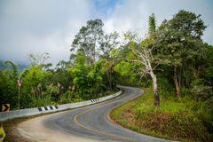 Curve road on mountain. S-shaped curve in the road down the mountain Royalty Free Stock Images