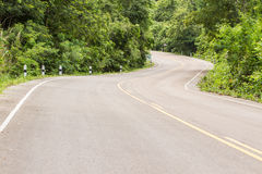 Curve Road in the mountain. Village forest road and car in the mountiamn Royalty Free Stock Images
