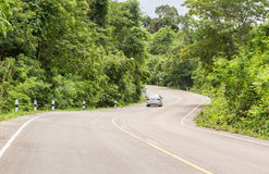 Curve Road in the mountain. Village forest road and car in the mountiamn Stock Photo
