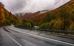 Curve road through mountains on autumn rainy day Royalty Free Stock Photos