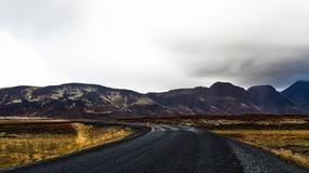 Curve Road Near Mountains during Daytime royalty free stock photography