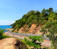 Curve road with sea view and blue sky at Khung Wiman Beach, Chan Royalty Free Stock Image