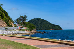 Curve road with sea view and blue sky at Khung Wiman Beach, Chan. Taburi Thailand stock photography