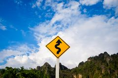 Curve Road Sign On The Mountain Stock Photos
