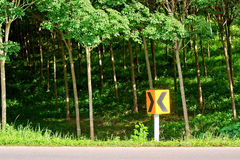 Curve road sign beside the road Stock Photography