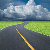 Curve road and yellow line. Head to the storm stock photography