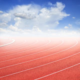 Curve of a running track and blue sky Royalty Free Stock Photography