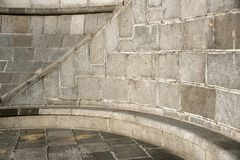 Curve section of a granite stone wall and floor Royalty Free Stock Photo