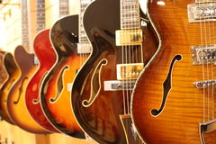 Curve shape. Beautiful shiny electric guitars in line royalty free stock photography
