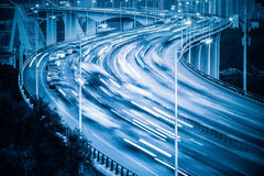 Curve shape approach bridge in nightfall. Abstract busy traffic background royalty free stock photo