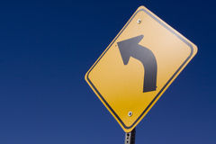 Curve sign. Curve ahead road sign on blue sky royalty free stock image