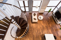 Curve stairs in spacious living room Stock Photo