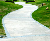 Curve stone path in garden Stock Photo