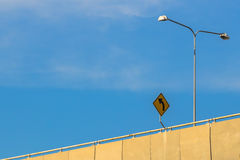 Curve Warning Sign. A road sign alerts motorists to a curving Highway Stock Image