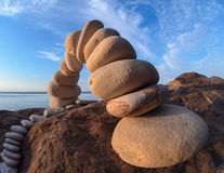 Curve of white pebbles. Curve of pebbles in the form of a arch on the coast Stock Images