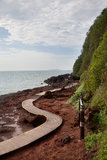 Curve wooden walkway by the sea Stock Photos