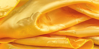 Curve yellow fabric Stock Images