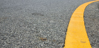 Curve yellow line on street Royalty Free Stock Images