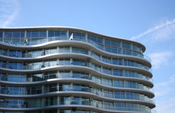 Curved apartment building Stock Images