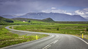 Curved asphalt road in high mountains Royalty Free Stock Photo
