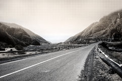 Curved asphalt road in high mountains of ilisu, Gakh, Azerbaijan. Greyscale landscape Royalty Free Stock Image