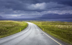 Curved asphalt road in Iceland Royalty Free Stock Photography