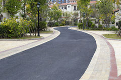 Curved asphalt road in keith carter living area Stock Images