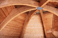 Curved beam wooden roof. Wooden roof structure - curved beam traditional construction style in Podhale, Poland. Pine wood Stock Images