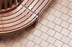 Curved Bench & Tile Floor Stock Image