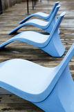 Curved Blue Chairs on Pier Royalty Free Stock Images